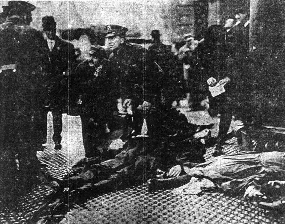 """Photo of New York Shirtwaist Factory Holocaust; Taking Down Description of the Dead."" The Pensacola Journal. March 31, 1911. Library of Congress"