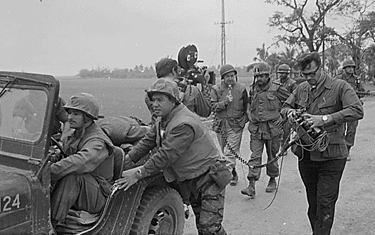 Walter Cronkite and a CBS crew interviewing the commanding officer of the 1st Battalion, 1st Marines, during the Battle of Hue City, Feb. 2, 1968, in Vietnam. National Archives
