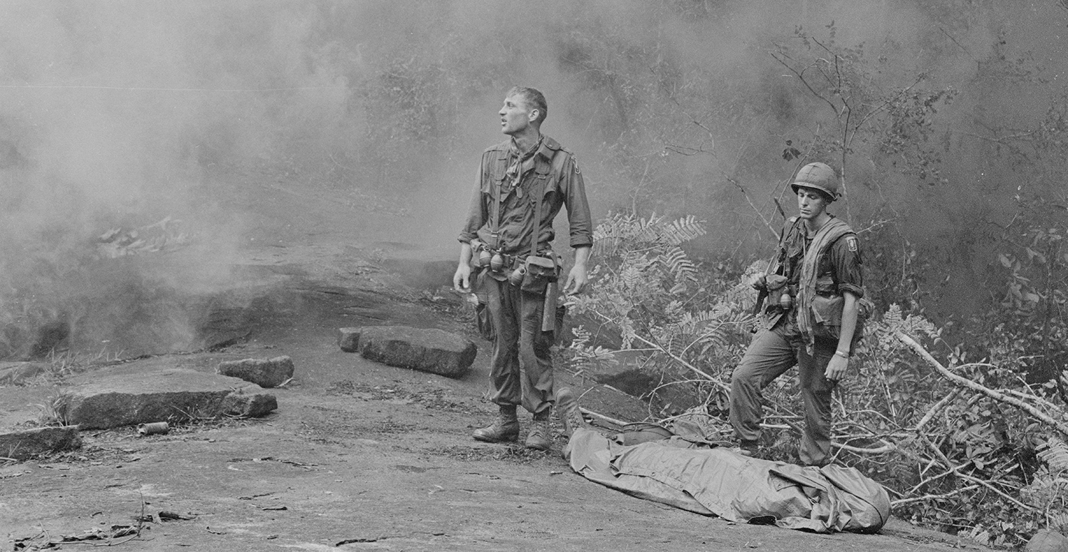 Long Khanh Province, Republic of Vietnam. SP4 R. Richter, 4th Battalion, 503rd Infantry, 173rd Airborne Brigade (left) and Sergeant Daniel E. Spencer (right), staring down at their fallen comrade. National Archives