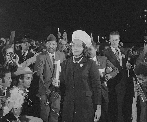 Coretta Scott King holding a candle and leading a march at night to the White House as part of the Moratorium to End the War in Vietnam, which took place on October 15, 1969. Library of Congress