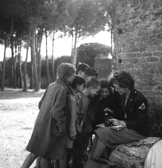 Frissell with Europe's Children [Toni Frissell with children], March 1945